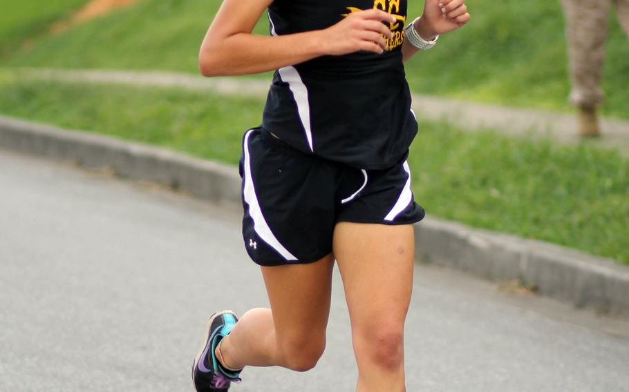 Kadena senior Ana Hernandez, the reigning Far East champion, heads for the finish of Wednesday's Okinawa Activities Council cross-country meet at Camp Foster, Okinawa. Hernandez won in 19 minutes, 7 seconds, best time for a Pacific runner this season and also a school and district record.