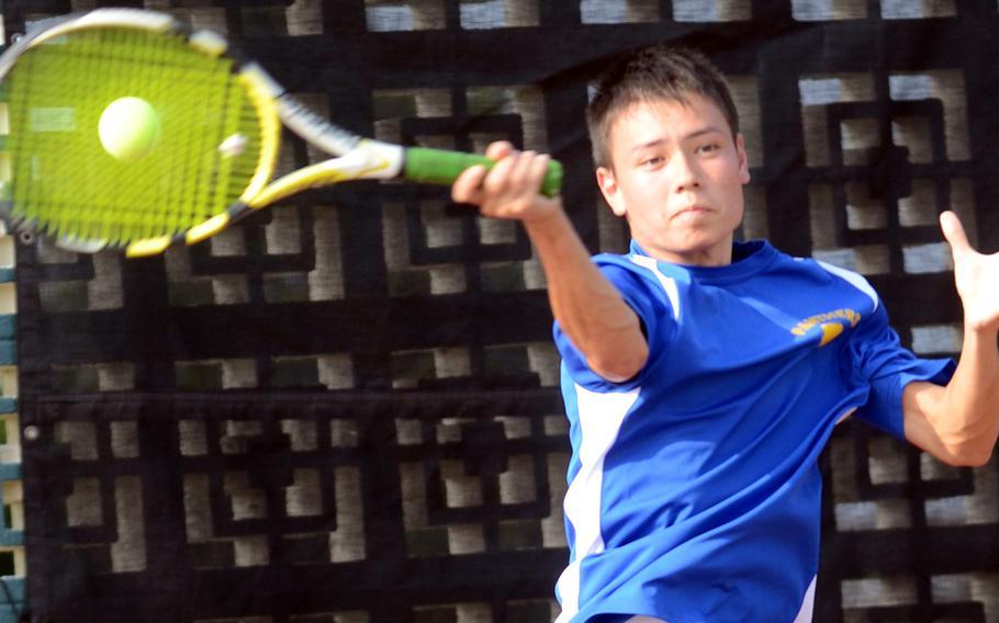 Yokota's Shintaro Clanton smacks a forehand volley against American School In Japan's Yosuke Higashi during Tuesday's boys singles quarterfinal match in the Far East High School Tennis Tournament at Kadena Air Base, Okinawa. Higashi won 8-3.