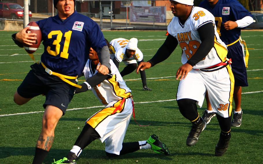 Navy's Scott Mai tries to elude two Army defenders during Saturday's Korea Army-Navy flag football rivalry game at Yongsan Garrison, South Korea. The soldiers routed the sailors 62-0, improving to 14-3 in the Peninsula Trophy series.