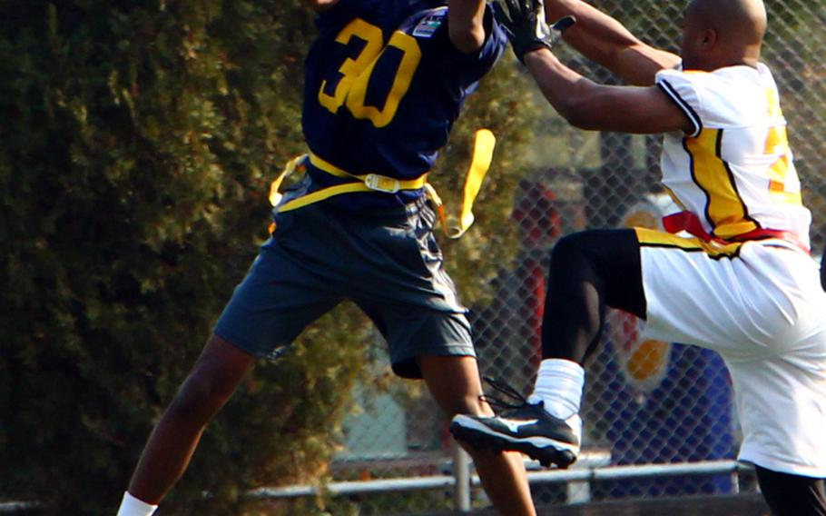 Navy's Joseph Chambers goes up to catch a pass against an Army defender during Saturday's Korea Army-Navy flag football rivalry game at Yongsan Garrison, South Korea. The soldiers routed the sailors 62-0, improving to 14-3 in the Peninsula Trophy series.