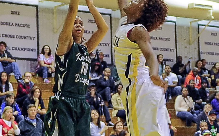 Kubasaki's Ameyna Saunders-Jackson shoots over Kadena's Montaya Jones during Friday's Okinawa Athletics and Activities Council girls high school basketball game at Kadena Air Base, Okinawa. The Panthers won 46-39.
