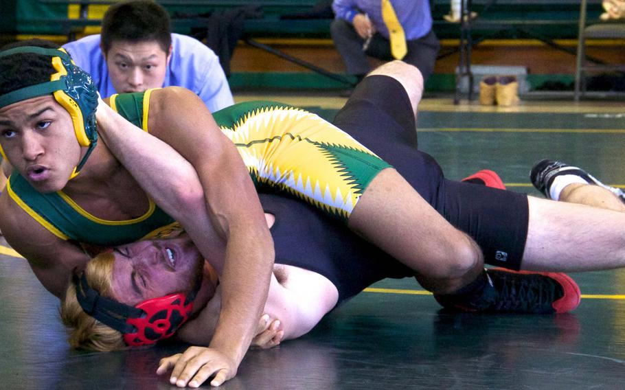 Robert D. Edgren's Kaleb Atchison gets the upper hand on E.J. King's Thomas McGrath during Saturday's DODDS Japan dual-meet tournament at Misawa Air Base, Japan. Atchison went unbeaten at 141 pounds and the Eagles won four of their five duals to finish second.