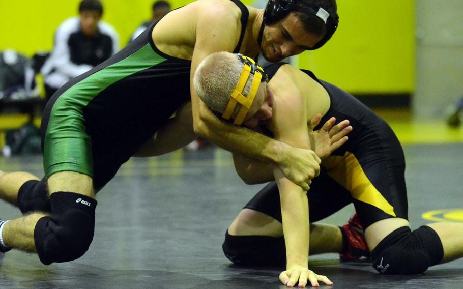Kubasaki's Tyler Russel battles Kadena's Michael Anderson at 135 pounds during Wednesday's Okinawa Athletics and Activities Council high school wrestling dual meet at Kadena Air Base, Okinawa. Russel won by technical fall 8-0 in 1 minute, 16 seconds.