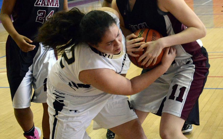 Humphreys' Sophia Nocera and Zama's Alexandra Chiarenza battle for the ball as Zama's Destinee Howze watches during Monday's pool-play game in the Far East High School Girls Division II Basketball Tournament at Camp Walker, South Korea. Zama won 14-9.