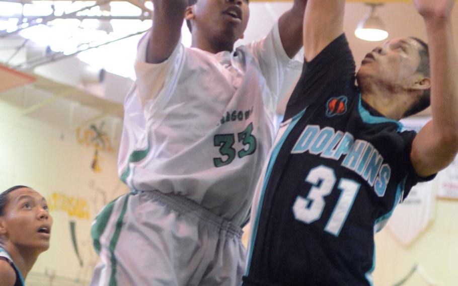 Kubasaki's Matt Ashley goes to the basket against Southern's Dominic Afaisen during Monday's pool-play game in the 66th Far East High School Boys Division I Basketball Tournament at Camp Foster, Okinawa. The Dragons won 63-46.