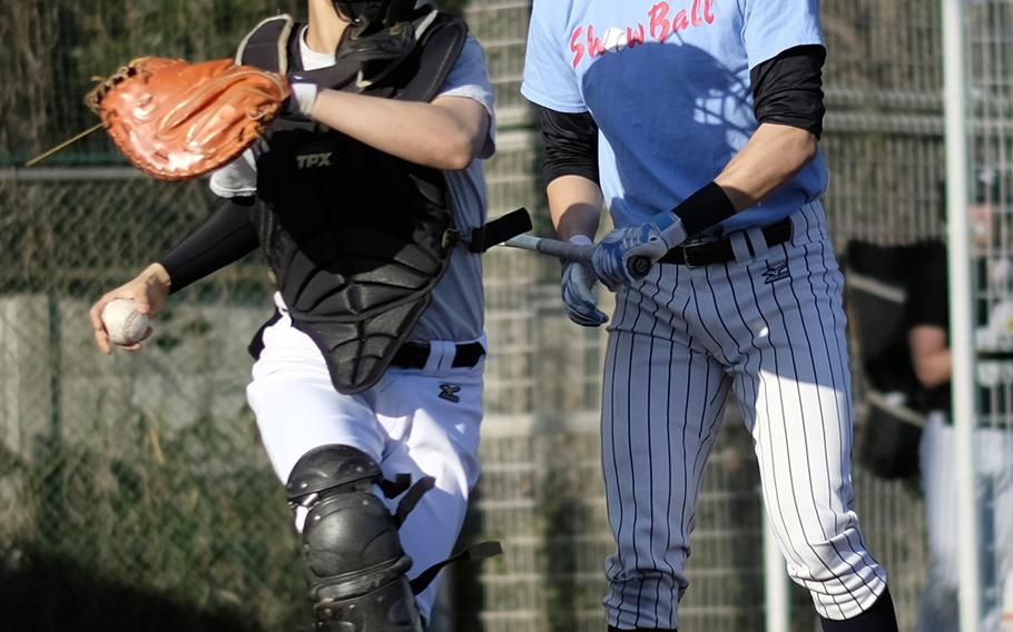 American School In Japan catcher Kenji Yoshi attempts to throw out a base stealer during a team scrimmage Wednesday in Chofu, Japan. ASIJ is the returning Far East Division I champion.