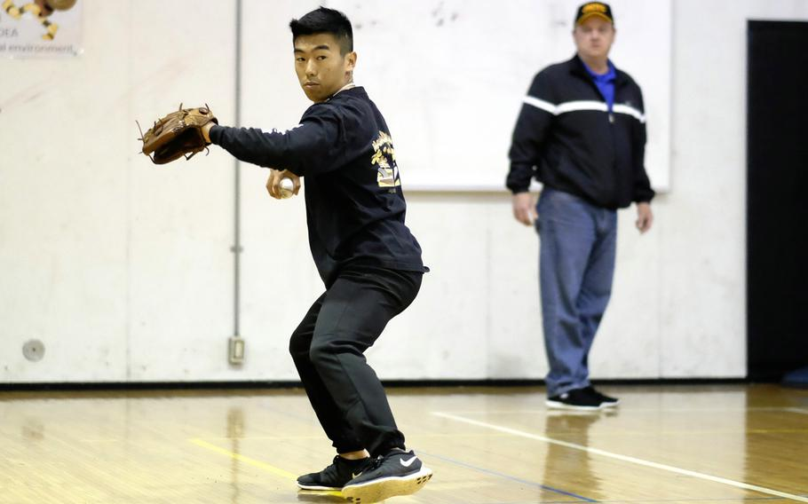 Zama pitcher Keiyl Sasano practices in the school's gymnasium during spring training at Camp Zama, Japan on Tuesday, March 11, 2015. Zama is the returning Far East Division II champion.