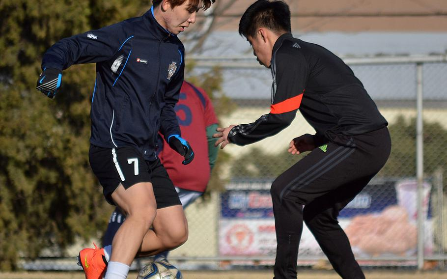 Seoul American sweeper HoKyong Adkins and defensive midfielder David Han go through their practice paces on Wednesday. The Falcons are in a rebuilding year after having lost seven starters from last year's team.