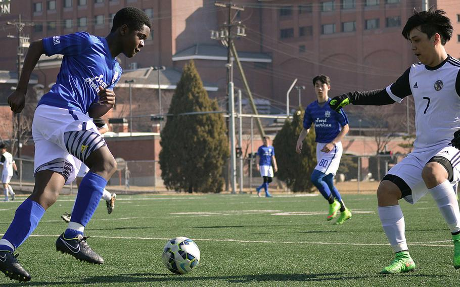 Seoul American's Kevin McGuire gets set to boot the ball past Taejon Christian's Albert Jang. Jang and the Dragons blanked the Falcons 1-0 in Seoul American's Korea soccer season opener.