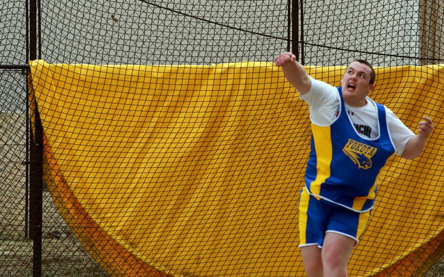 Yokota sophomore Christian Sonnenberg tosses the disc 48.77 meters in Saturday's track meet at Yokota. That put him less than 2 meters behind the Pacific record of 50.65 set by Yokota's Stephe DeSantis, a record that has stood for 27 seasons.