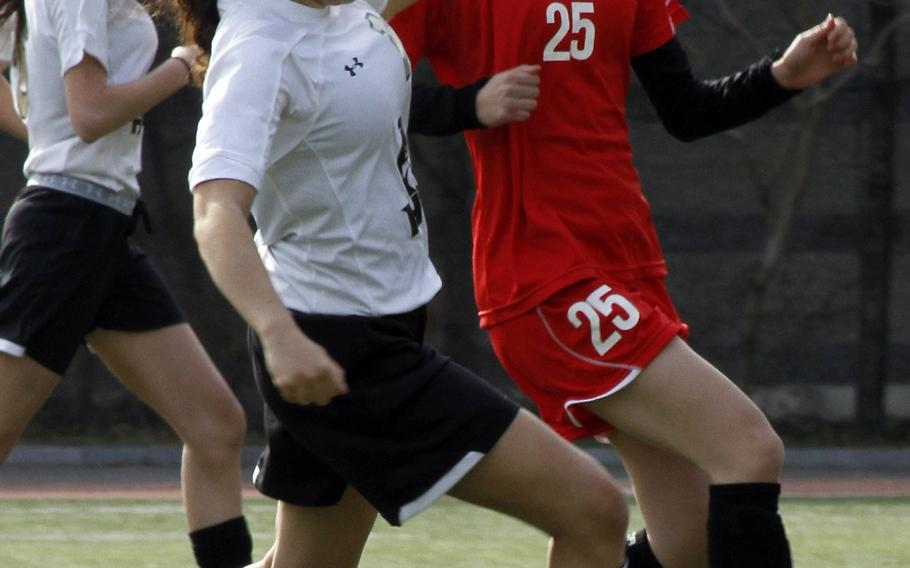 Humphreys' Isabella Nocera and Seoul Foreign's Claire Shin battle for the ball during Saturday's Korea girls soccer match. The Crusaders downed the Blackhawks 10-1.