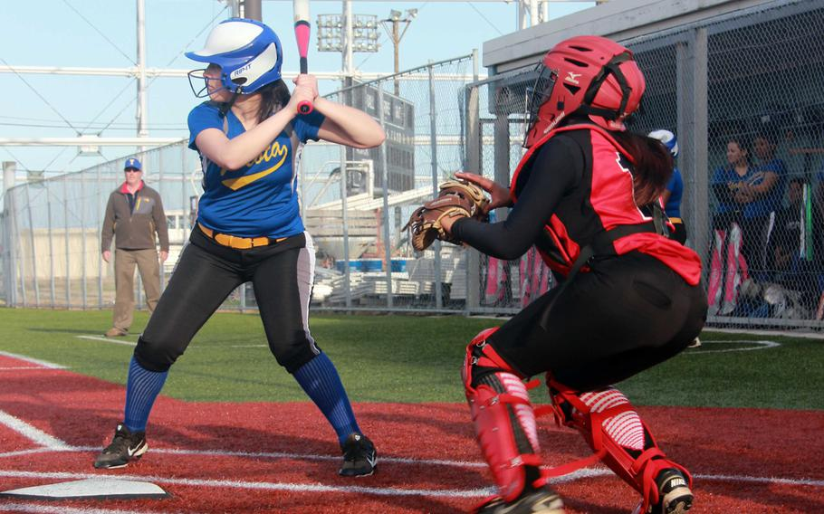 Yokota's Anysia Torres stands in at the plate in front of Nile C. Kinnick catcher DeShauna Carter during Tuesday's DODDS Japan-Kanto Plain girls softball game. Torres allowed three hits, walked none and struck out two as the Panthers routed the Red Devils 30-2 in three innings, Yokota's first win at Kinnick in the Far East Tournament era.