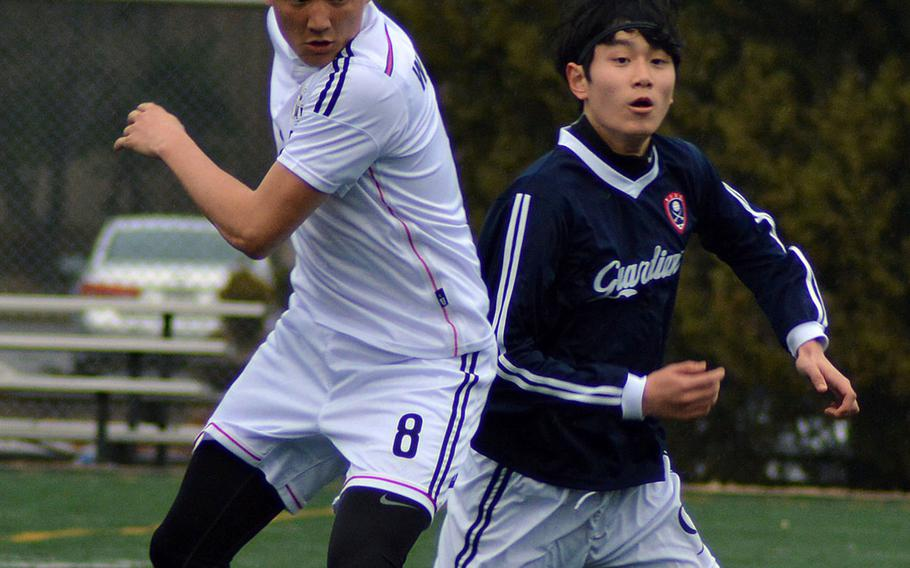 Seoul American's Max Weekley and Yongsan's Hannes Schwedhelm battle for the ball during Wednesday's Korea boys soccer match, won by the host Falcons 1-0.