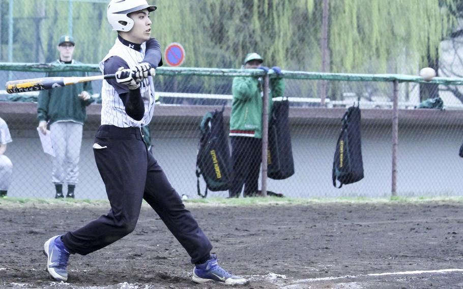 Zama's K.J. Cruz gets set to lean into a pitch for a triple against Robert D. Edgren during Friday's DODDS Japan baseball game. The Trojans swept a twin bill from the Eagles 6-1 and 19-4.