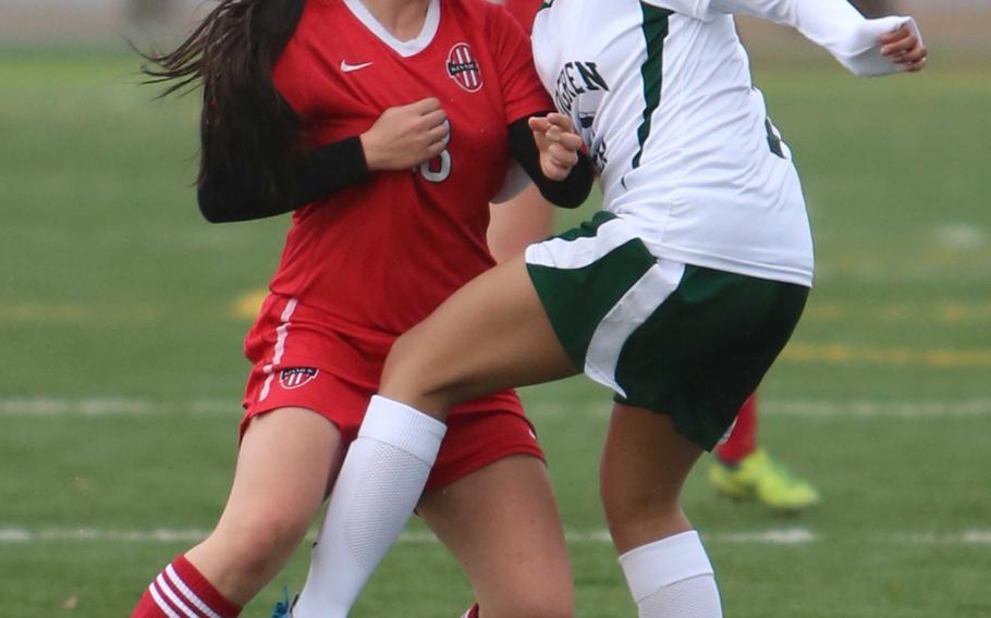 Nile C. Kinnick's Kiralyn Kawachi and Robert D. Edgren's Sopheary Soun collide during Friday's DODDS Japan girls soccer match. The Red Devils won 8-0.