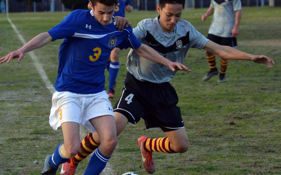 Matthew C. Perry's Justin Hill and Yokota's Ray Hernandez battle for the ball along the sideline during Friday's DODDS Japan boys soccer match. The teams played to a 3-3 draw.