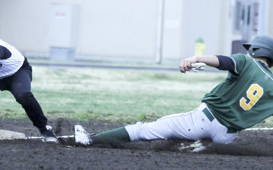Robert D. Edgren's Isaac Victorino slides in safely at third base ahead of the tag of Zama's Dakota Lyles during Saturday's DODDS Japan baseball game. The Eagles won 7-0 to avert a three-game sweep.