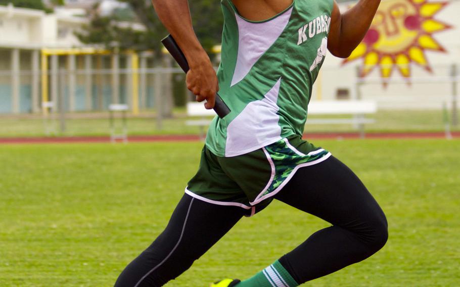 Kubasaki's Johann Wright runs the anchor leg of the 400-meter relay during Okinawa's season-opening track and field meet. Kubasaki won in 45.48 seconds.