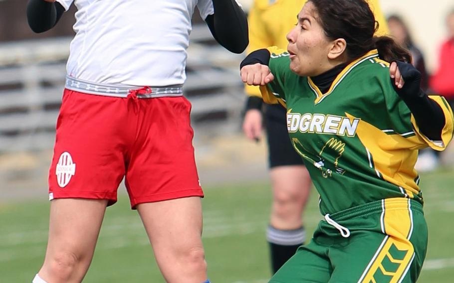 Nile C. Kinnick's Raena Schoeff heads the ball next to Robert D. Edgren's Gabriela Gonzalez during Saturday's DODDS Japan girls soccer match. The Red Devils won 5-0 to sweep the weekend series.