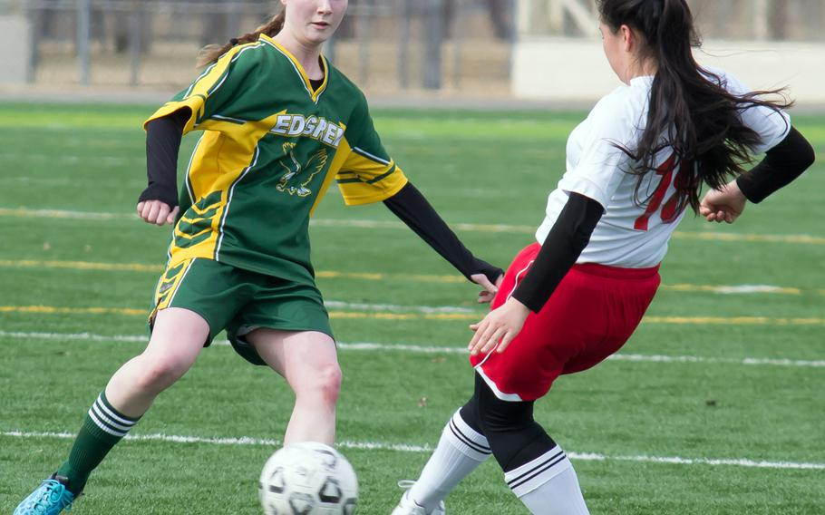 Robert D. Edgren's Elizabeth Long and Nile C. Kinnick's Kiralyn Kawachi scrum for the ball during Saturday's DODDS Japan girls soccer match. The Red Devils won 5-0 to sweep the weekend series.