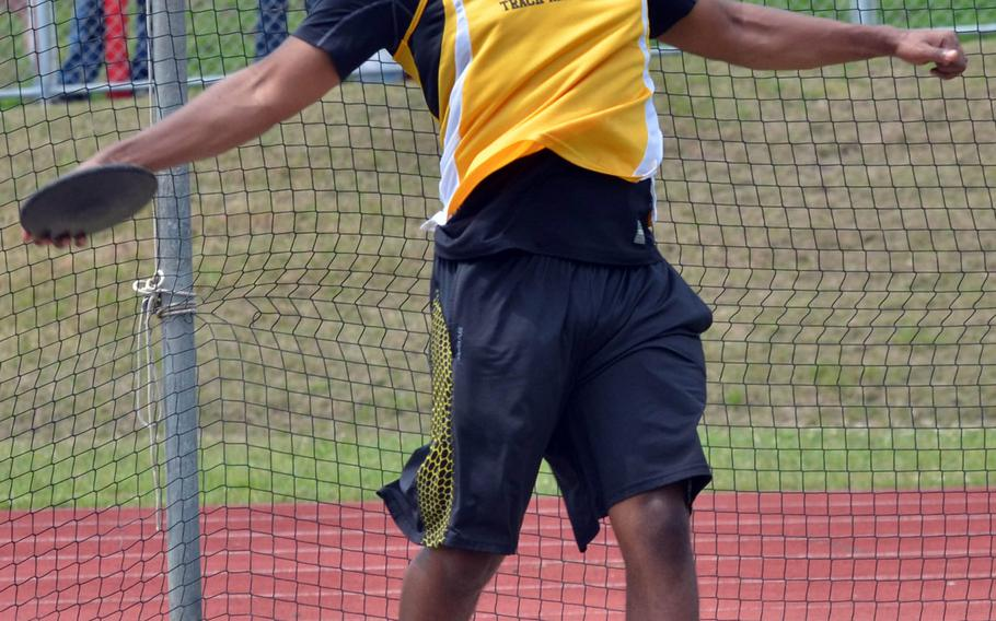 Kadena's Michael Clayton lets the discus fly, an event he won with a throw of 113 feet, 6 inches in Saturday's Okinawa season-opening track and field meet.