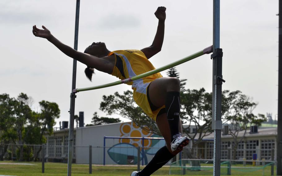 Kadena's Jasmine Rhodes clears 5 feet to win the girls high jump in Saturday's Okinawa season-opening track and field meet.