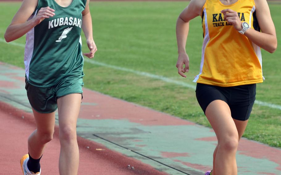 Kubasaki's Zoe Jarvis and Kadena's Wren Renquist lead the pack during the 3,200-meter run in Saturday's Okinawa season-opening track and field meet. Renquist swept the 3,200, 1,600 and 800 races.