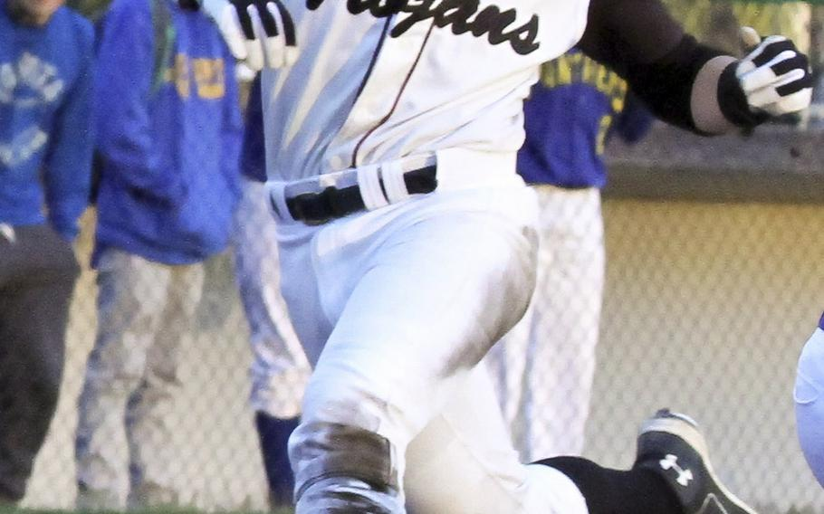 Zama's Lawrence Miner crosses home plate against Yokota during Tuesday's DODDS Japan/Kanto Plain baseball game. The host Trojans edged the Panthers 3-1 in a pitchers' duel as Yokota's Leo Austin and Zama's Keiyl Sasano combined for 24 strikeouts.
