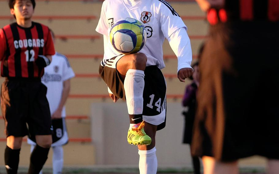 Zama's Malik Wilkes juggles the ball before hosting St. Maur on March 24, 2015 at Camp Zama, Japan. Wilkes scored the final goal beating St. Maur 2-0, extending the Trojans' record to 5-0.