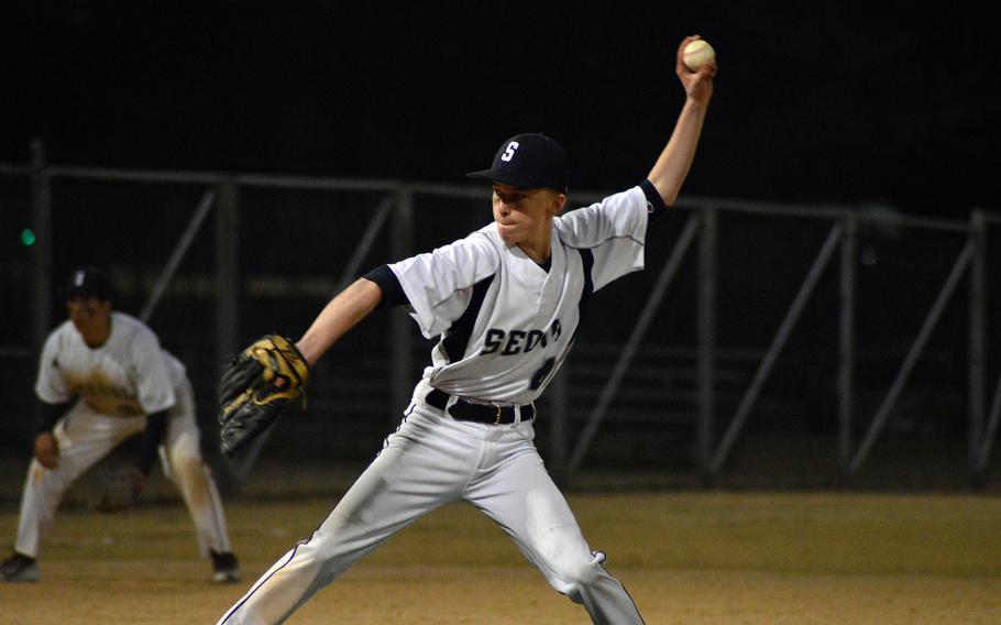 Seoul American pitcher Jonathan Stewart readies the ball during a game against Kubasaki on Friday. Kubasaki won 14-7.