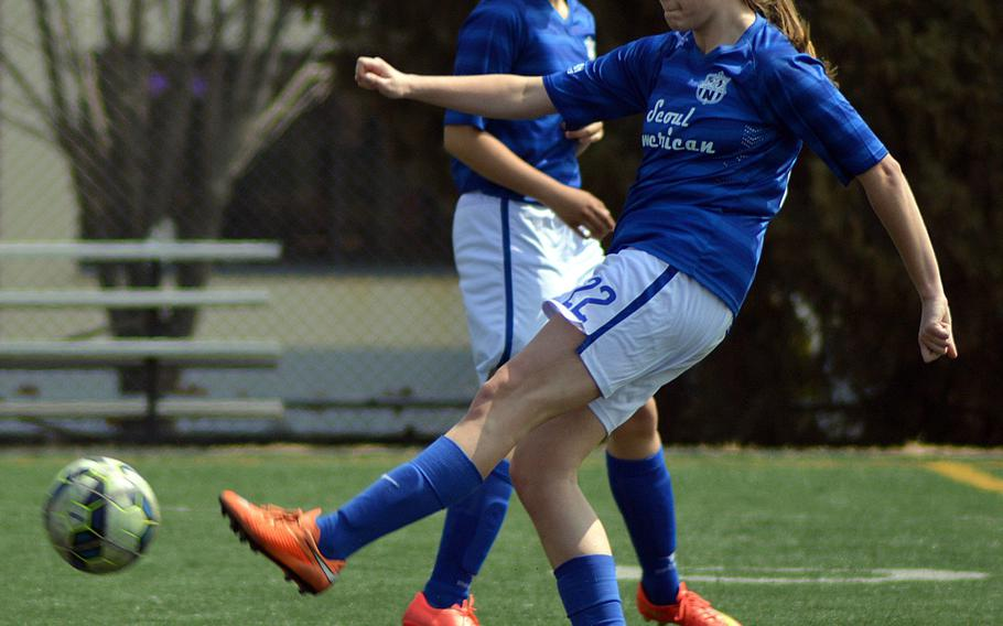 Seoul American's Charley Smith boots the ball against Daegu during Saturday's Korea girls soccer match. The Falcons won 6-1.