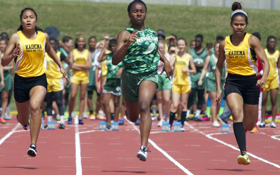 Kubasaki's Kaelyn Francis is flanked by Kadena's Apryl-Len Cabase and Monet Baker during the girls 100-meter dash in Saturday's Okinawa track and field meet. Francis won in 12.51 seconds.