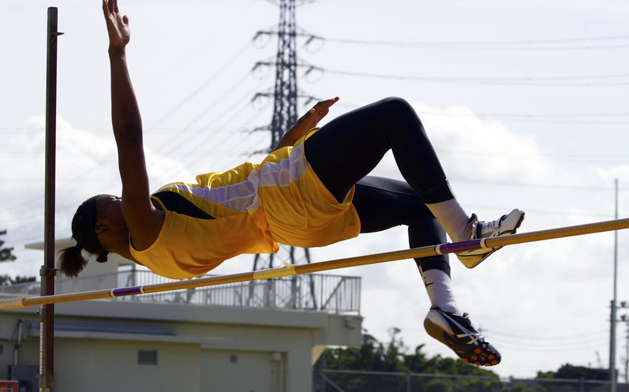 Kadena's Jasmine Rhodes clears the bar during the girls high jump in Saturday's Okinawa track and field meet. Rhodes won with a jump of 4 feet, 10 inches.