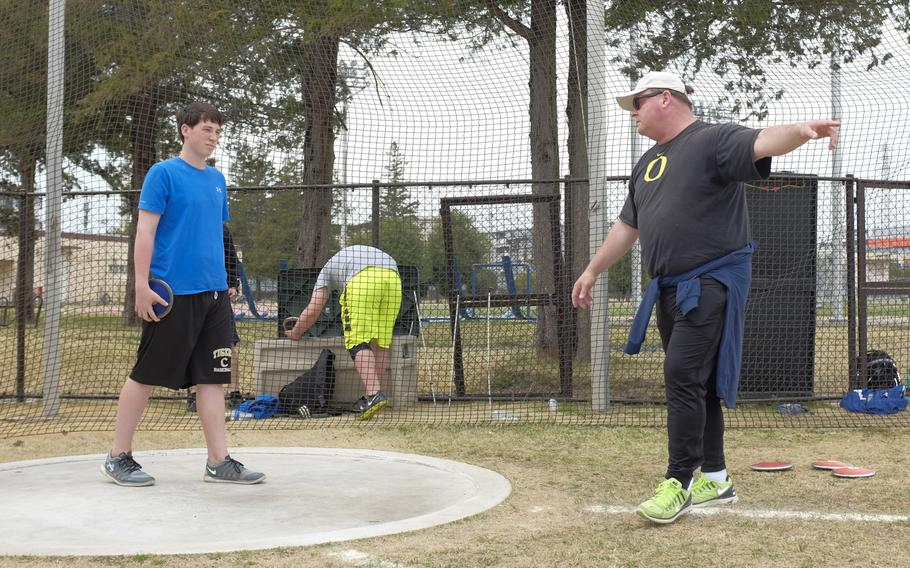 Ken Flax, a two-time Olympian and the NCAA record holder in the hammer throw, coaches high school and middle school athletes at Yokota Air Base, Japan on Sunday, March 29, 2015. Flax was among four former Olympians to visit Yokota as part of the World Records Camp.