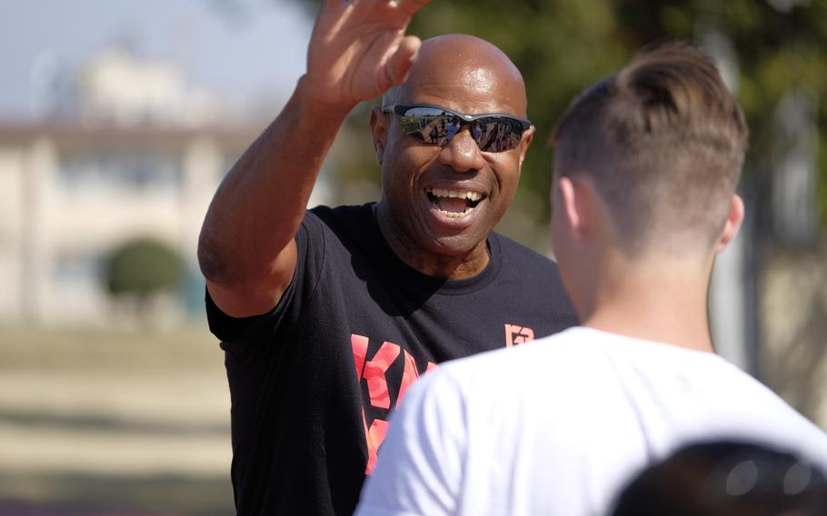 Mike Powell, a two-time world champion and the world record holder in long jump, coaches high school and middle school athletes at Yokota Air Base, Japan on Sunday, March 29, 2015. Powell was among four former Olympians to visit Yokota.