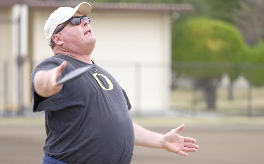 Ken Flax, a two-time Olympian in the hammer throw, coaches discus fundamentals to high school and middle school athletes at Yokota Air Base, Japan on Sunday, March 29, 2015. Flax was among four former Olympians to visit Yokota as part of the World Records Camp.
