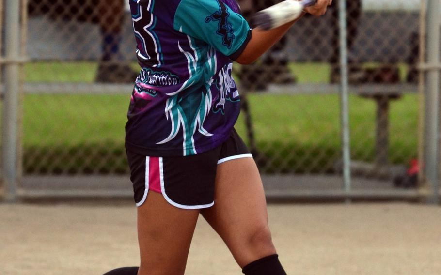 Okinawa Dragons pinch-hitter Destiny Velarde connects on a bases-clearing double against Misfitz in the women's opening game in the 2015 Firecracker Shootout Softball Tournament. The two-time defending champion Dragons beat Misfitz 13-3. Velarde is a sophomore at Kubasaki High School who played for the Far East Division I Tournament runner-up Dragons as a freshman last season.