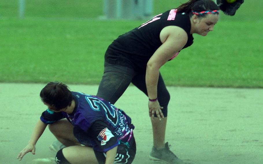 Okinawa Dragons baserunner Megan Eliz is forced out at second base by Misfitz shortstop Breanna Campbell during the women's opening game in the 2015 Firecracker Shootout Softball Tournament. The two-time defending champion Dragons beat Misfitz 13-3.