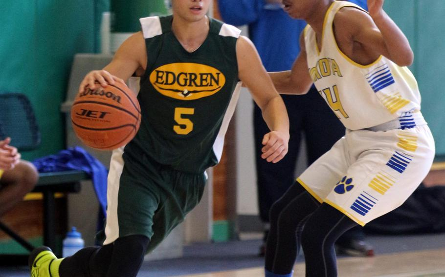 Robert D. Edgren's Jun Doria dribbles against Yokota's Kory Sterling as Panthers coach Tim Pujol watches in the background during Saturday's boys basketball game, won by the Panthers 64-42.