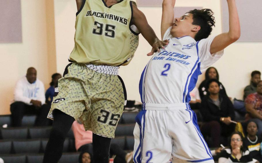 Humphreys' Jalen Hill drives to the basket past Seoul American's Miguel Villarreal during Saturday's boys basketball game. The Blackhawks beat the Falcons for the third straight regular-season game 67-41, the biggest margin of victory over Seoul American in Humphreys' four-year school history.
