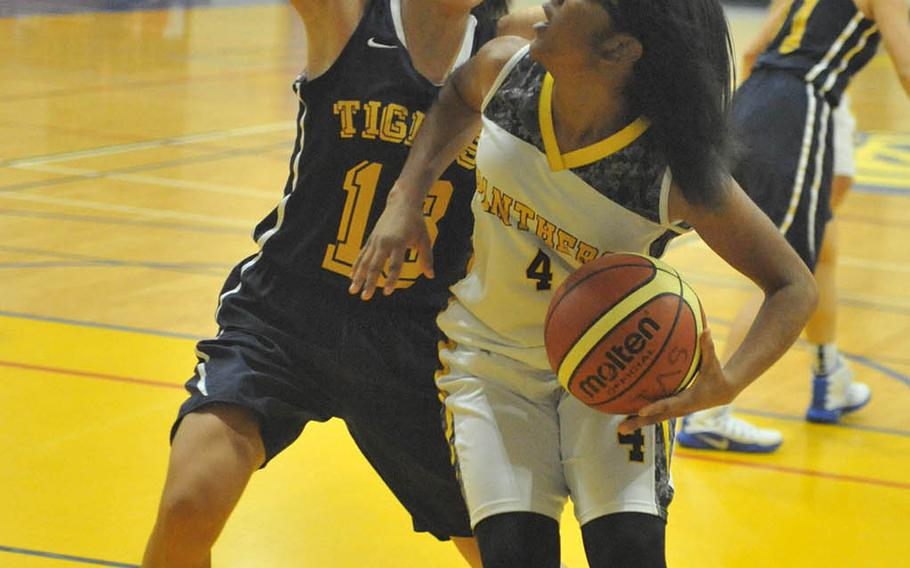 Kadena's Rhamsey Wyche looks for room against the Taipei American defense during Saturday's girls game in the 2nd Taipei American School Basketball Exchange. The Panthers lost to the host Tigers 53-46, their first loss in their first five games played in Tapiei the last two Januarys.