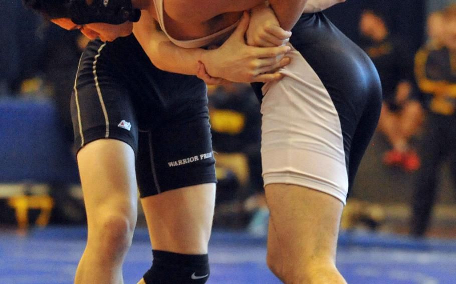 """Daegu 148-pounder Hunter Lane tries to lift Zama's Curtis Blunt during the title bout in Saturday's """"Beast of the Far East"""" wrestling tournament.  Lane, a Far East runner-up a year ago, won by technical fall 10-0 in 2 minutes, 58 seconds. He was one of just two Daegu wrestlers in the tournament; the other, Jake Dexter, took third at 158."""