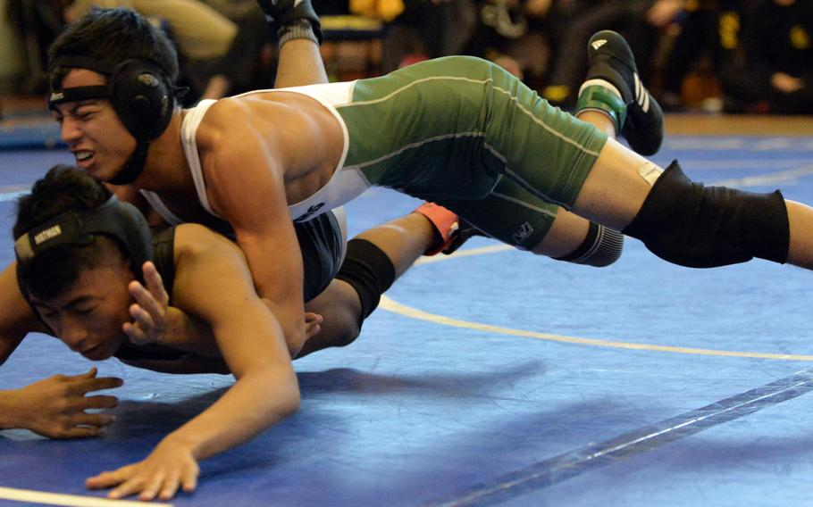 """Kubasaki's Kyan McCarty takes down Kadena's Austin Martino during the title bout in Saturday's """"Beast of the Far East"""" tournament. McCarty pinned Martino in 1 minute, 24 seconds."""