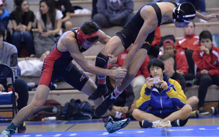 """Nile C. Kinnick 115-pounder Chon Dareing tries to tie up the legs of Kadena's Demetrio De La Rosa during the title bout in Saturday's """"Beast of the Far East"""" tournament. Dareing beat De La Rosa, a defending Far East champion, by technical fall 10-0 in 2 minutes, 22 seconds."""