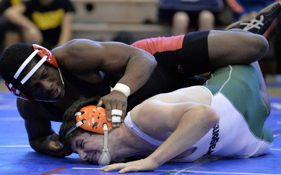 """Nile C. Kinnick 180-pounder Dwayne Lyon gains control of Kubasaki's Nick Burwell during the title bout in Saturday's """"Beast of the Far East"""" tournament. Lyon, a defending Far East champion, won by technical fall 13-0 in 3 minutes, 15 seconds."""