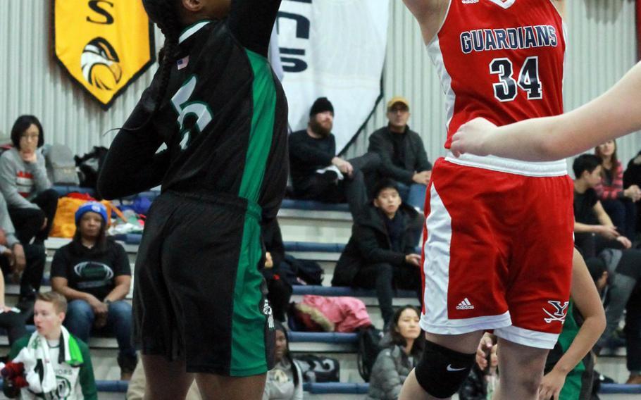 Yongsan's Rachael Ko shoots over Daegu's Kennedi Williams during Saturday's girls basketball game, won by the Guardians 38-4.
