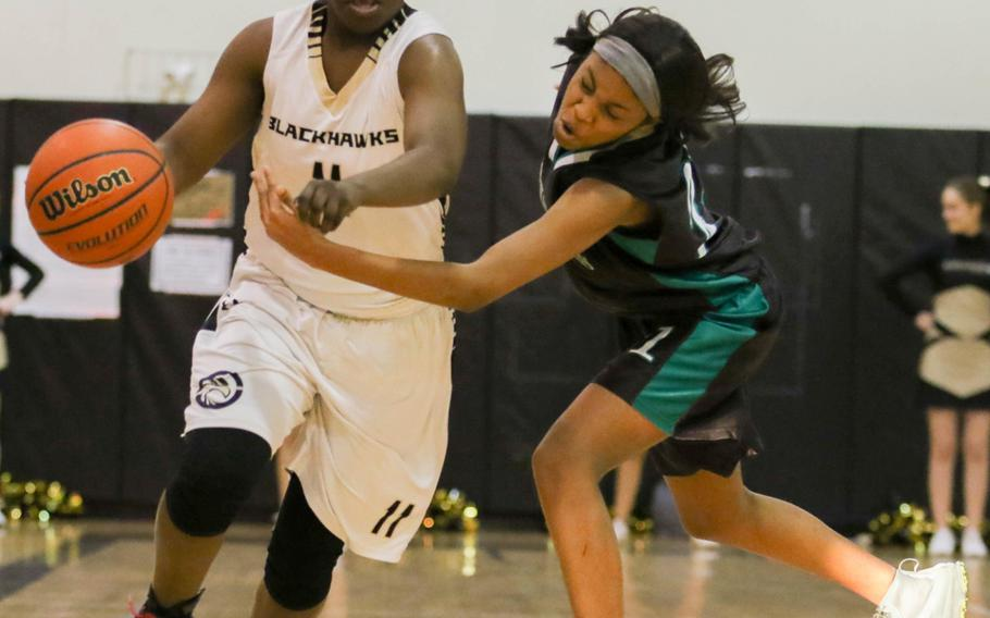 Humphreys' Myah Childs drives past Daegu's Asia Green during Tuesday's girls basketball game, won by the host Blackhawks 36-20.