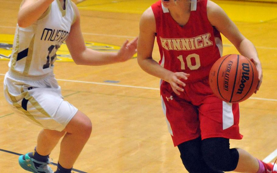 Nile C. Kinnick's Kailee Rucker drives past American School In Japan's Allie Rogers on Day 2 Friday of the 1st ASIJ Kanto Classic. The Mustangs downed the Red Devils 38-26 and earned the top seed in Saturday's single-elimination playoffs.