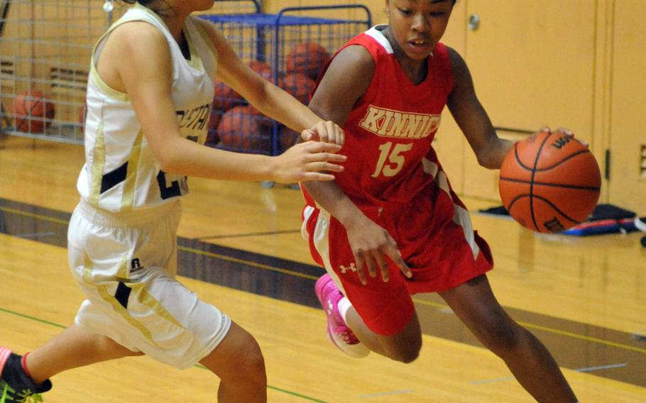 Nile C. Kinnick's Venus Hill tries to dribble past American School In Japan's Erin Chang on Day 2 Friday of the 1st ASIJ Kanto Classic. The Mustangs downed the Red Devils 38-26 and earned the top seed in Saturday's single-elimination playoffs.