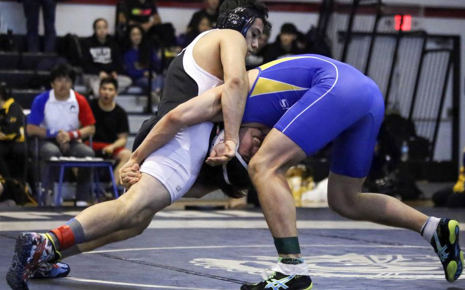 Zama's Curtis Blunt and Jihoon Seo of St. Mary's  tangle in the 148-pound championship  during Saturday's Zama  Invitational. Blunt captured first place and Seo placed second.
